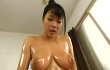 Busty oiled MILF fucked by older guy