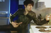 Leather clad twink jerks off while smoking