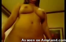 Busty Asian babe sucking cock