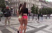 Two sexy girls walking butt naked through town