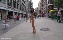 Hot girl enjoys walking completely naked on a street