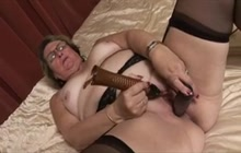 Granny plays with big dildos