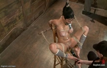 Bound lesbian with toes tied to nipples