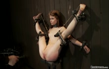 Suspended upside down slave gets toyed
