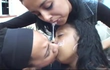 Lesbians kissing and spit swapping